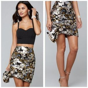 BEBE metallic ruched floral mini skirt with bow
